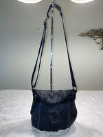 The Sak Deena Black Leather Foldover Bucket Crossbody Bag