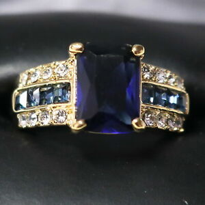 7.90Ct Emerald Cut Blue Sapphire Solitaire Engagement Ring 14K Yellow Gold Over