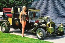 Pat Priest who played Marilyn Munster with the car from the show, 1960's