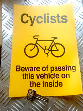 CYCLISTS BEWARE OF PASSING THIS VEHICLE  ON THE INSIDE WARNING STICKER