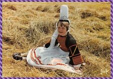 La Britain Little girl wearing a costume Bigouden