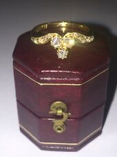 An Art-Deco Diamond ring (0.75ct in total) in 18K Yellow Gold. Circa 1940's.
