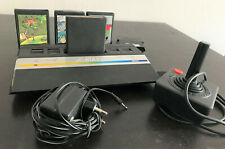 Atari 2600 Jr. + paddle controller and 4 games (Pole Position, Super Breakout)