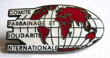 Pins insigne du Comité de Parrainage et de Solidarité Internationale.