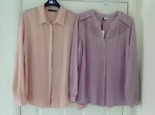 Ladies blouses. 1 Dusty pink & 1 peach. Both long sleeved. Size 16