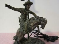 "BRONZE COWBOY LAMP WITH TULIP SHADE, MARKED "" ROSA c) 1996 GREEN SHADE WORKS."