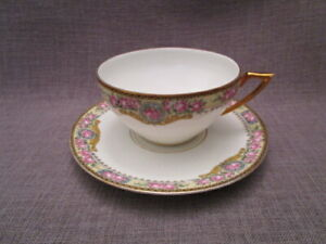 Tasse a thé ancienne en porcelaine de Limoges