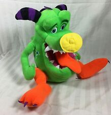 Monster green plush monster with purple and black horns. scary, stuffed Animal