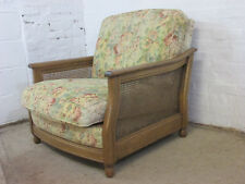 Ercol Bergere Golden Dawn Solid Ash and Cane Armchair with Floral Upholstery