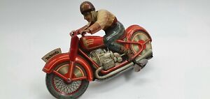 Tin Toy  Wind up Technofix motorcycle -Working but need adjustment-