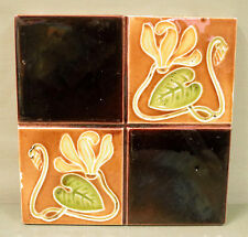 AN ENGLISH ART NOUVEAU TILE- IMPRESSED MAJOLICA  - STYLIZED FLORAL