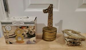 Gold Glittered Table Numbers 1-12  with gold painted wooden holders. Never used