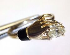 14K Yellow Gold Hand Holding a Marquis Diamond Ring with Black Enamel 5.5