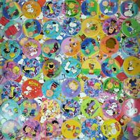 Lot of 50 Pogs Snoopy, Charlie Brown & The Peanuts Gang Milk Caps from 1990s