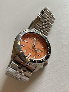 Seiko SKX011J1 Orange Dial Jubilee Bracelet Wrist Watch For Men.