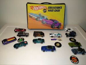 Hot wheels redlines lot of 12 cars played condition with case.