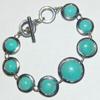 Faux turquoise graduated round cabochon shiny silver tone toggle clasp bracelet