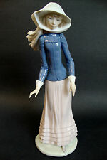 """Nao by Lladró Figurine *Lady with Hat and Headscarf* - 12 1/2"""" tall (Es 3 # 703)"""