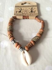 Surfer style tan beads with a shell bracelet