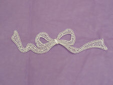 An ivory bridal Smaller Butterfly lace Applique/wedding lace motif for sale.