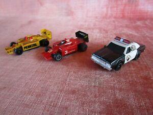 3 OLD VINTAGE AFX AURORA SLOT CARS 2 FORMULA 1 STYLE & POLICE HIGHWAY PATROL