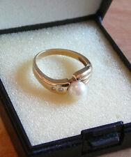 Goldring - 585 -  mit echter Perle und 2 Diamanten
