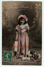 Carte postale ancienne | Fillette | Bonne année | Robe longue | Cadeaux | 1909