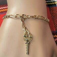 9 ct gold second hand hollow figaro ankle bracelet & yale key
