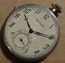 A good grade steel Waltham pocket watch movement in partial case & keeping time.