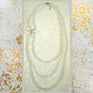 ConMIGoJ010075 three strings of pearls with removable triple flower pearl brooch