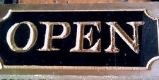 Small carved open sign