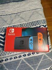 Nintendo Switch Console avec Paire de Joy-Con - Bleu/Rouge édition 2019.