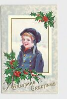 PPC POSTCARD CHRISTMAS BOY IN BLUE COAT WITH BRASS BUTTONS HOLLY BORDER EMBOSSED