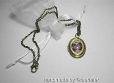 Vintage style Bronze locket with glass butterfly design necklace opens