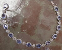 18K WHITE GOLD TANZANITE 8.24 CTW & DIAMOND 2.84 CTW BRACELET BY LEGACY DESIGNS