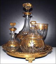 Riche service à absinthe, à décor floral et liseret or