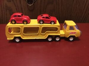 Vintage Buddy L Yellow Semi Car Carrier With Two Red Plastic Cars Good Cond.