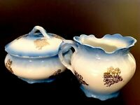ANTIQUE SMITH PHILLIPS CREAMER AND SUGAR SET. FENIX. BLUE WITH GOLD FLOWERS.