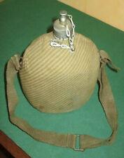 Vecchia borraccia di Partigiano alluminio e tela - rifoderata in guerra