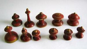 ANTIQUE CHESS PIECES LOT PAINTED RED . .
