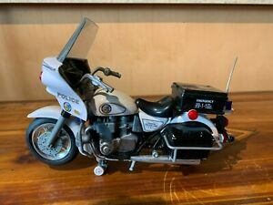 Model of Kawasaki police 1000 motorcycle  wit battery operated sounds.