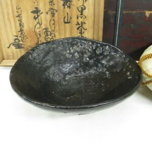 A071: Great, real old Japanese RAKU pottery tea bowl with wonderful atmosphere