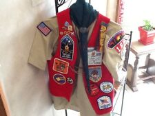 BOY SCOUT SHIRT WITH RED FELT VEST, NECKERCHIEF, SLIDE, AND MANY PATCHES & PINS