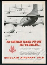 1958 American Airlines DC-7 plane filled sky Sinclair Aircraft Oils print ad