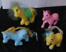 PHONEY PONEY LOT OF 4, VARIOUS FIGURES, BLUE, PINK, YELLOW, 1 PRETTY PET, NICE!