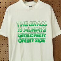 vtg 90s usa made Lofts the grass is always greener t-shirt XL gentrification