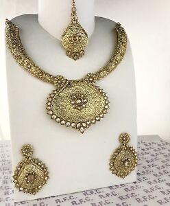 Gold traditional Indian mala pendant necklace earrings tikka kundan zirconia