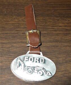 VINTAGE Ford  Backhoe Loader Metal  Watch Fob Mayville Implement Brown band