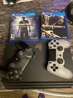 Sony PlayStation 4 Pro 1TB Jet Black Console with 2 Games and 2 Controllers 4K