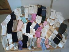 OVER 50 PAIRS OF SOCKS.-NEW BORN KIDS OF ALL AGES LADIES MEN  ( NEW )